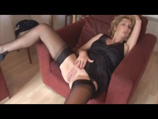 Mature_blonde_babe_in_stockings_and_open_girdle-480p