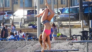 A Graceful Girl enjoy Gymnastics. So much fun at Muscle Beach