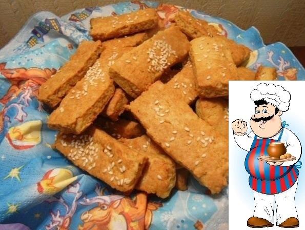 Сырные палочки с кунжутом Ингредиенты: Мука 1 стакан Ассорти сыров 200 г (можно использовать только плавленный сыр, например) Сливочное масло 100 г Яйцо 1 шт. Сода 1 ч.л. Соль на кончике ножа