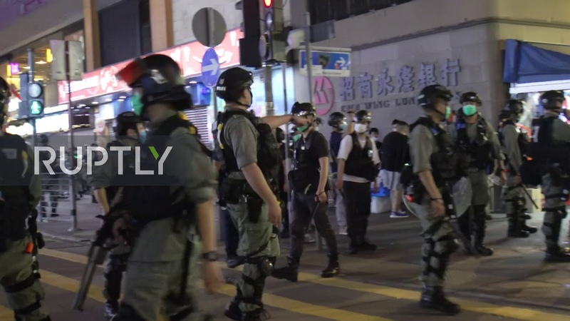 Hong Kong Police disperse protesters after scuffles in Legislative Council